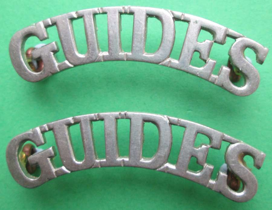 QUEEN VICTORIA'S OWN CORPS OF GUIDES WHITE METAL SHOULDER TITLES