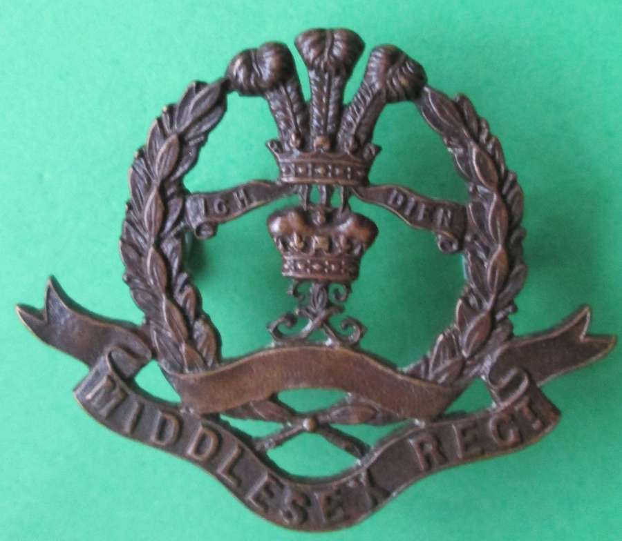 A 10TH MIDDLESEX TERRITORIAL REGT BADGE MADE BY JENNINGS AND CO