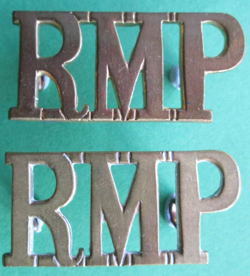 A PAIR OF RMP ( ROYAL MILITARY POLICE ) SHOULDER TITLES