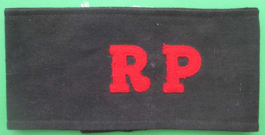 A WWII REGIMENTAL POLICE ARMBAND