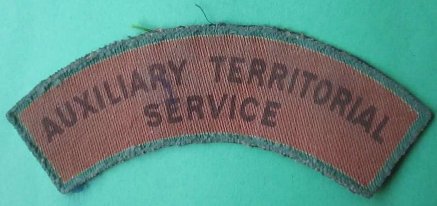 AN AUXILIARY TERRITORIAL SERVICE SHOULDER TITLE