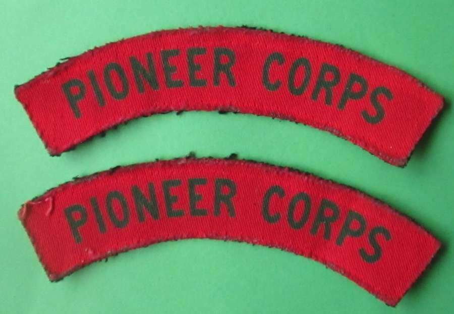 A PAIR OF PIONEER CORPS SHOULDER TITLES
