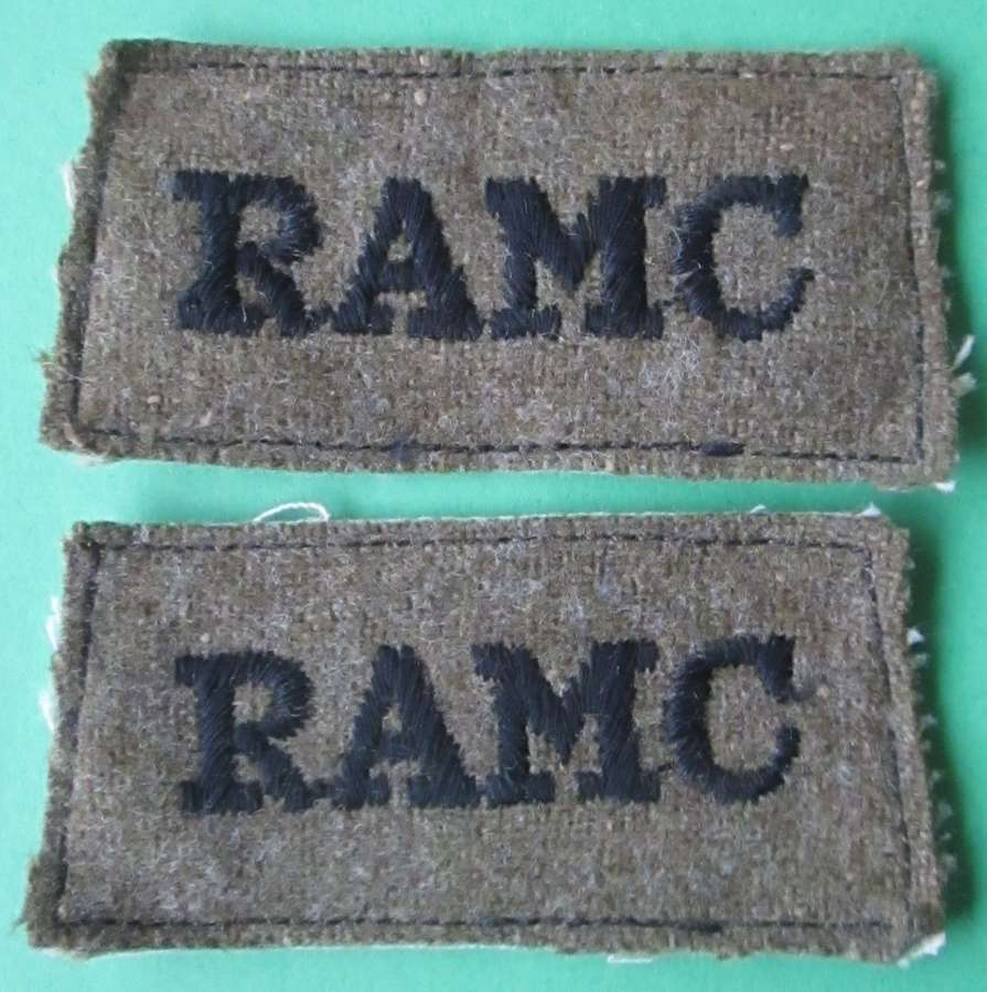 A PAIR OF ROYAL ARMY MEDICAL CORPS SLIP ON SHOULDER TITLES