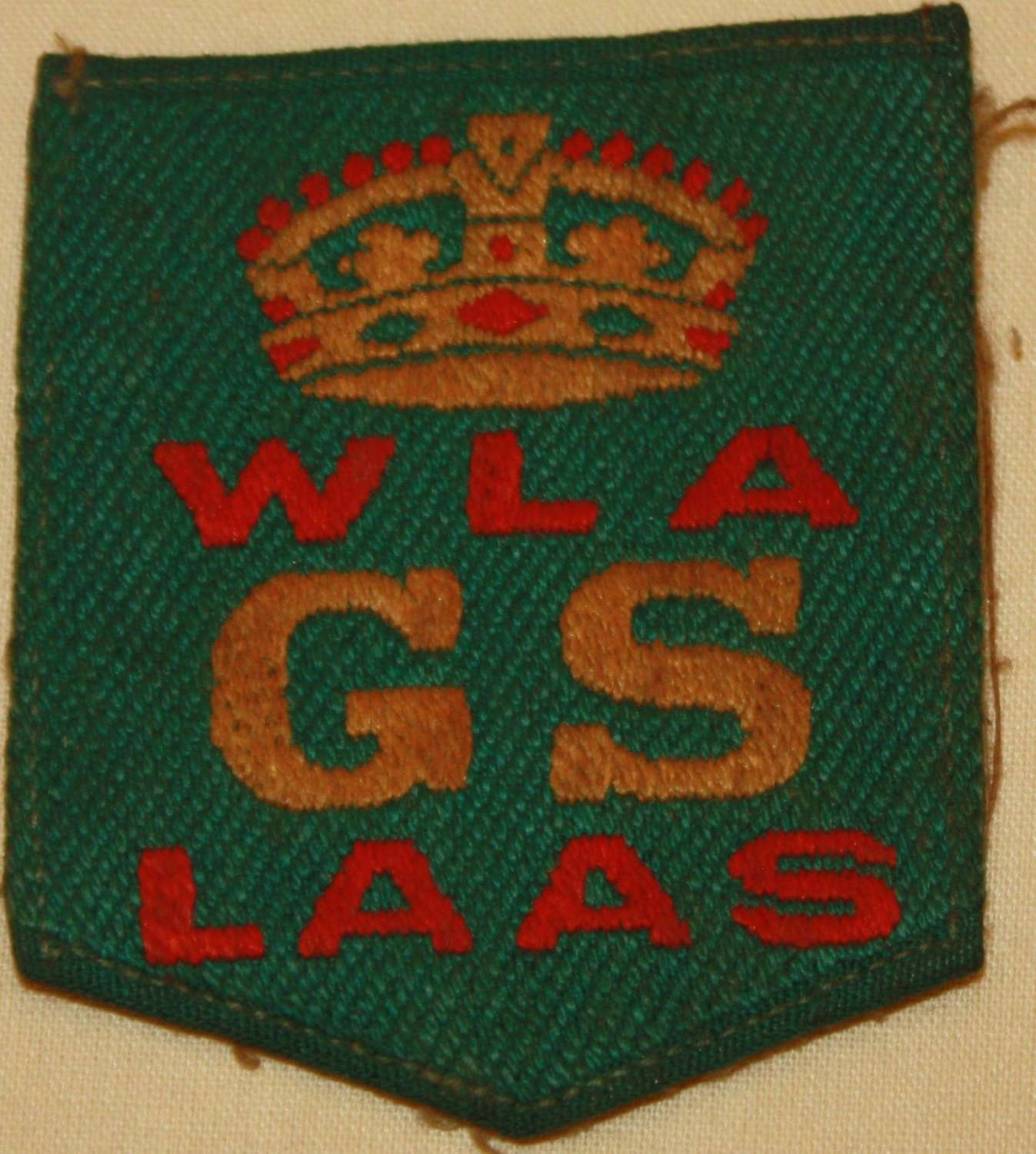 A WWI WOMENS LAND ARMY GOOD SERVICE ARM BADGE
