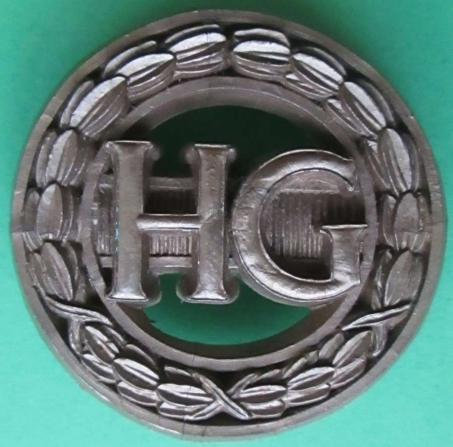 A PLASTIC WOMEN'S HOME GUARD AUXILLARY BADGE