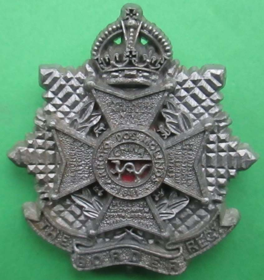 A WWII PLASTIC BORDER REGT CAP BADGE