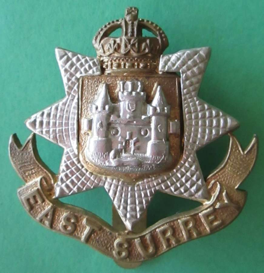 AN EAST SURREY REGIMENT CAP BADGE