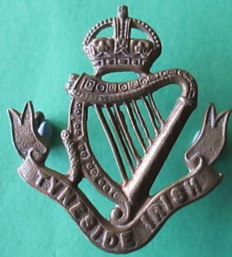 A TYNESIDE IRISH (34th FUSILIERS) REGIMENT BADGE