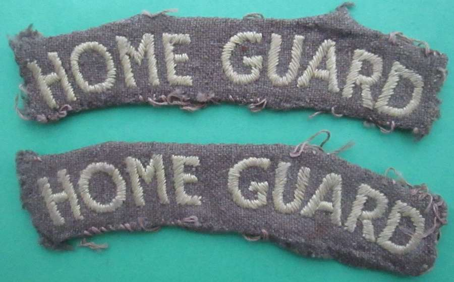 A PAIR OF HOME GUARD SHOULDER TITLES