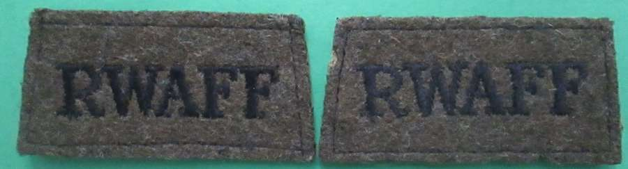 A PAIR OF RWAFF ( ROYAL WEST AFRICA FRONTIER FORCE )SLIDE ON TITLES