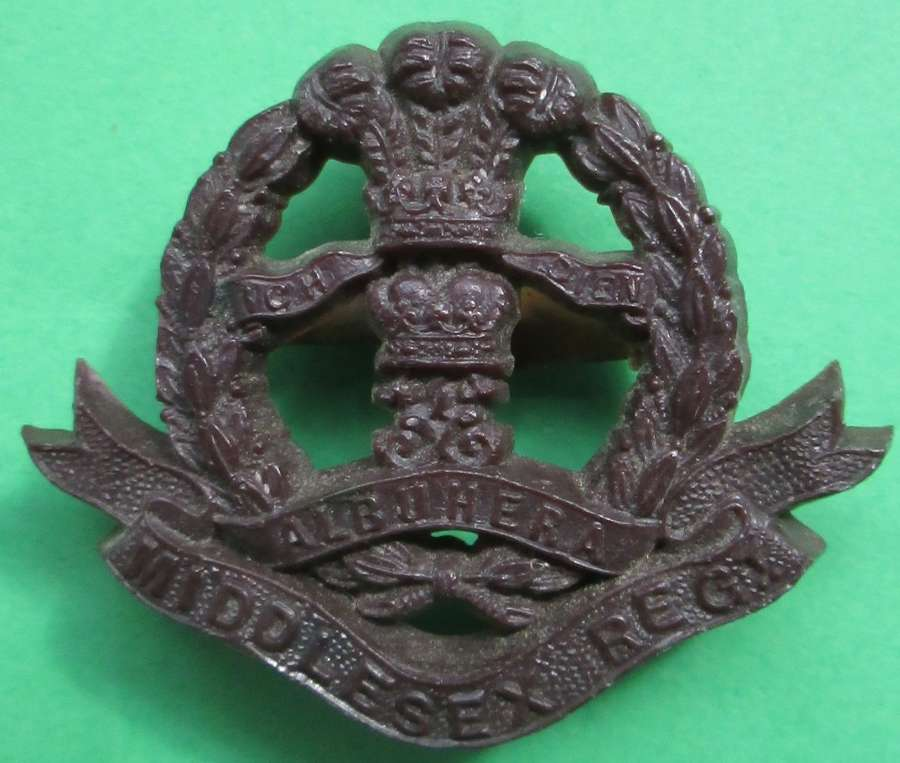 A MIDDLESEX REGIMENT PLASTIC BADGE