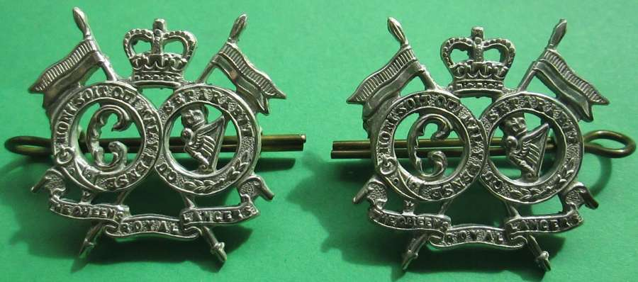 A PAIR OF QUEENS LANCERS SILVER PLATED COLLAR DOGS