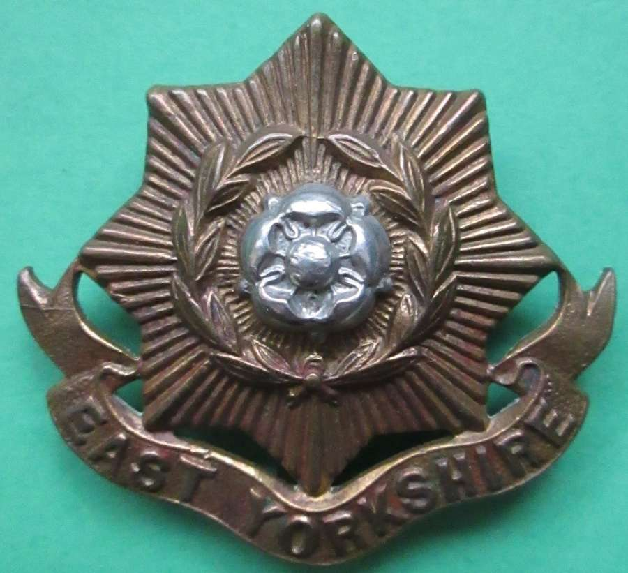 AN EAST YORKSHIRE REGIMENT CAP BADGE