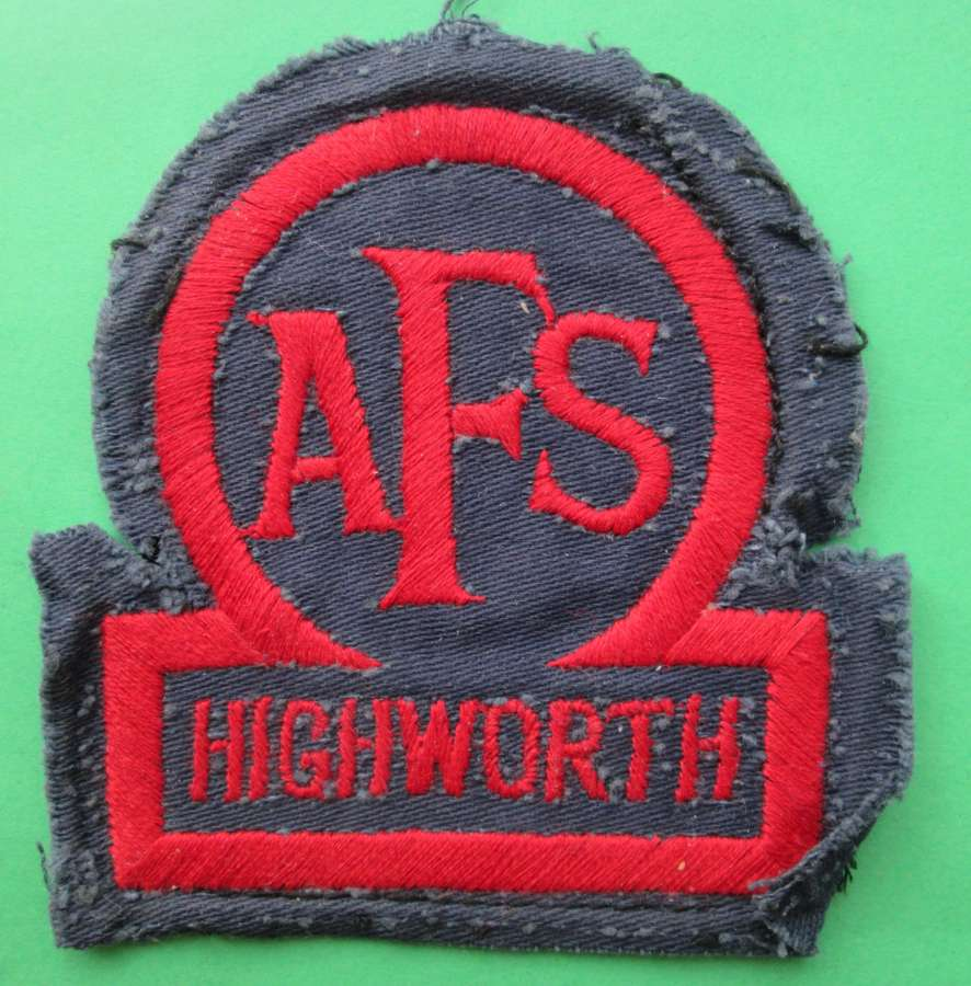 AN AUXILLARY FIRE SERVICE BADGE FOR HIGHWORTH