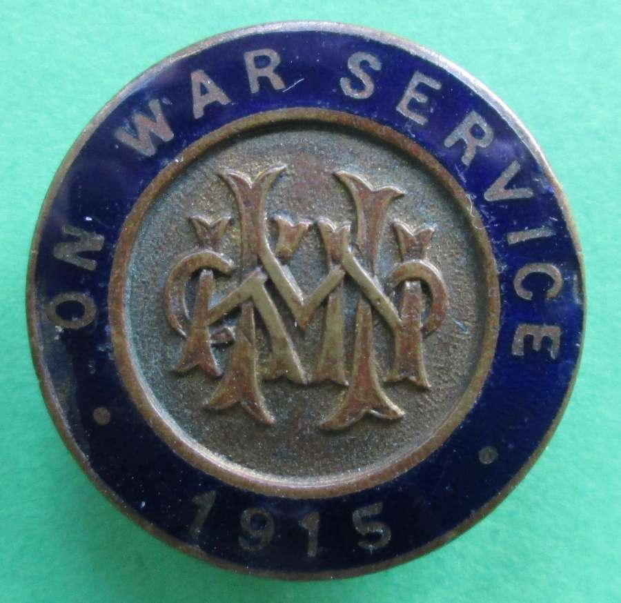 A 1915 WWI ON WAR SERVICE LAPEL BADGE