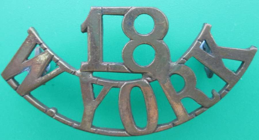 A 18TH WEST YORKSHIRE REGT SHOULDER TITLE ( BRADFORD PALS BATTALION )
