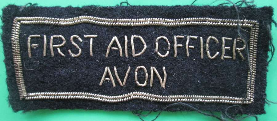 A CIVIL DEFENCE ARM BADGE FOR A FIRST AID OFFICER IN AVON