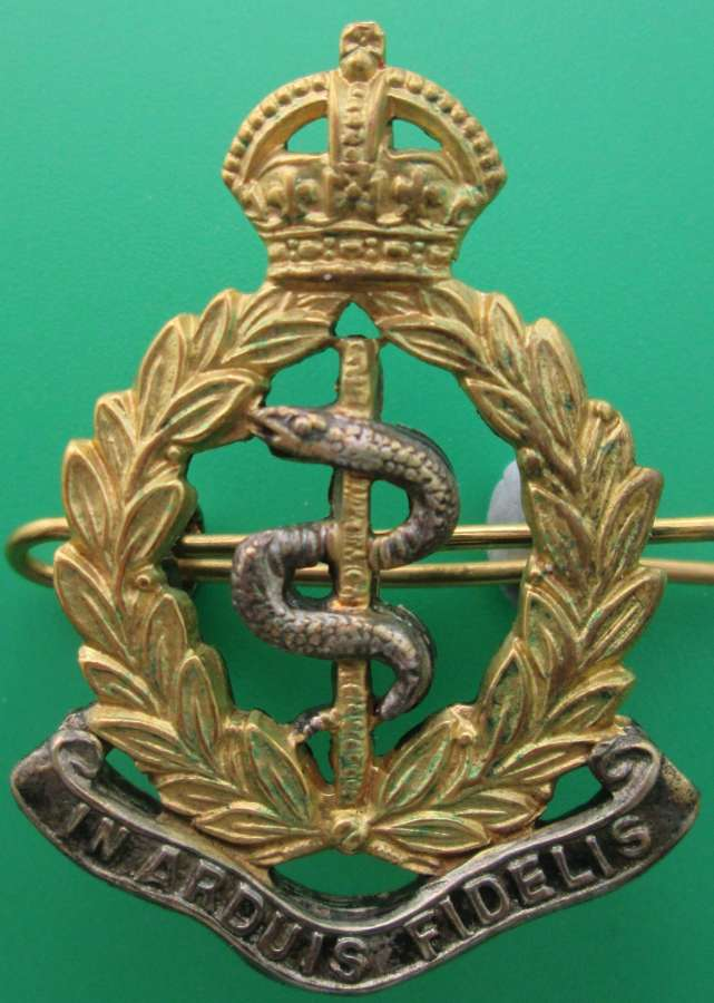 A SILVER AND GILT OFFICER'S RAMC CAP BADGE