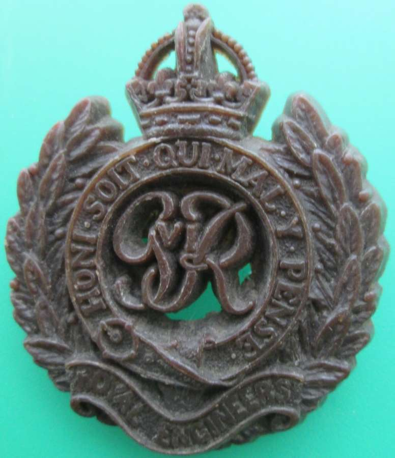 A PLASTIC ROYAL ENGINEERS CAP BADGE