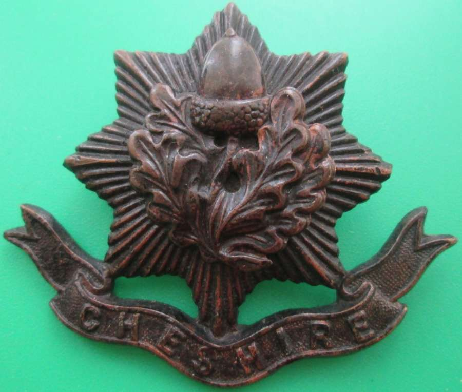 A BRONZE OFFICERS CHESHIRE REGIMENT CAP BADGE