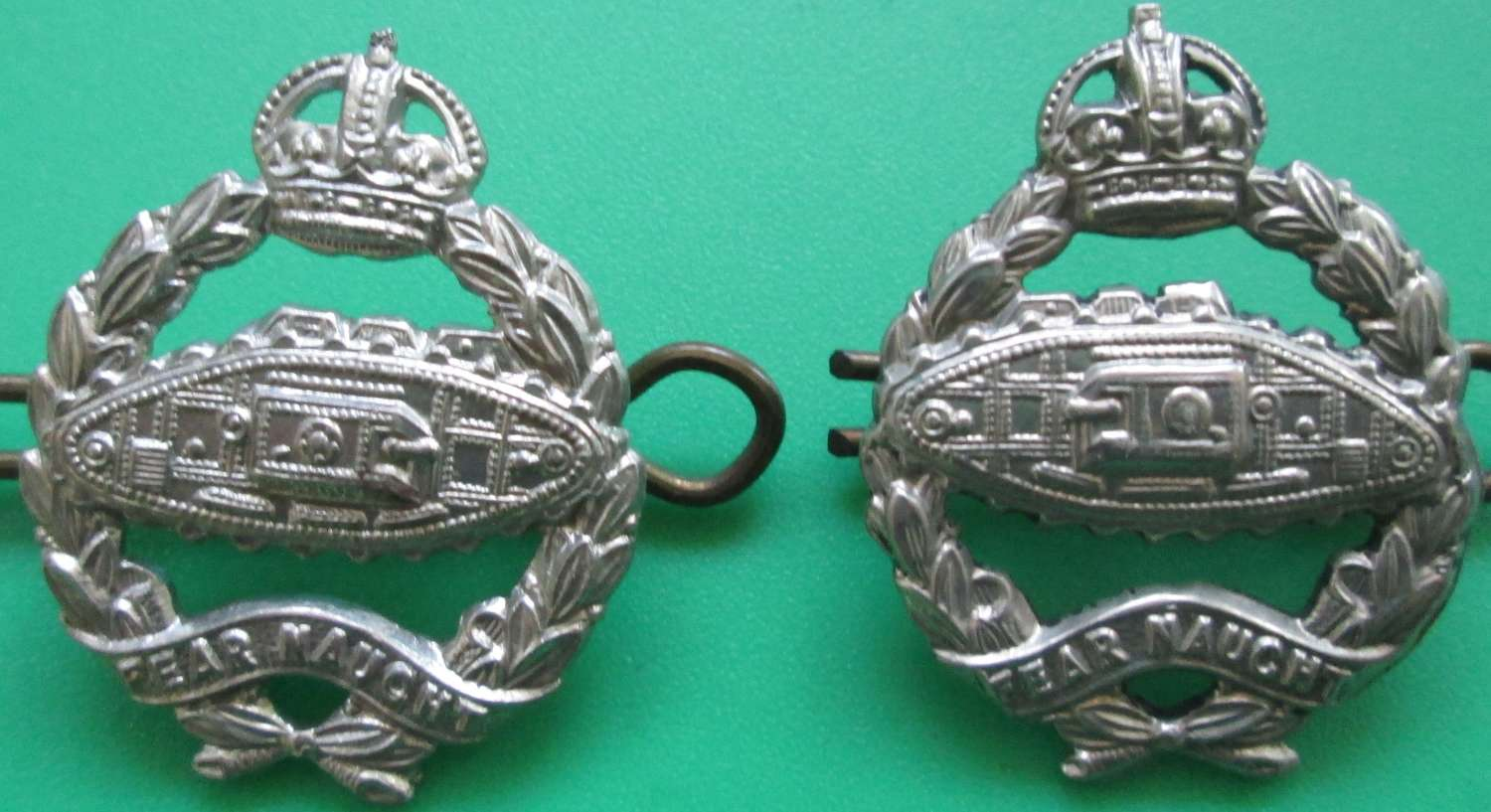 A PAIR OF ROYAL TANK CORPS COLLAR DOGS