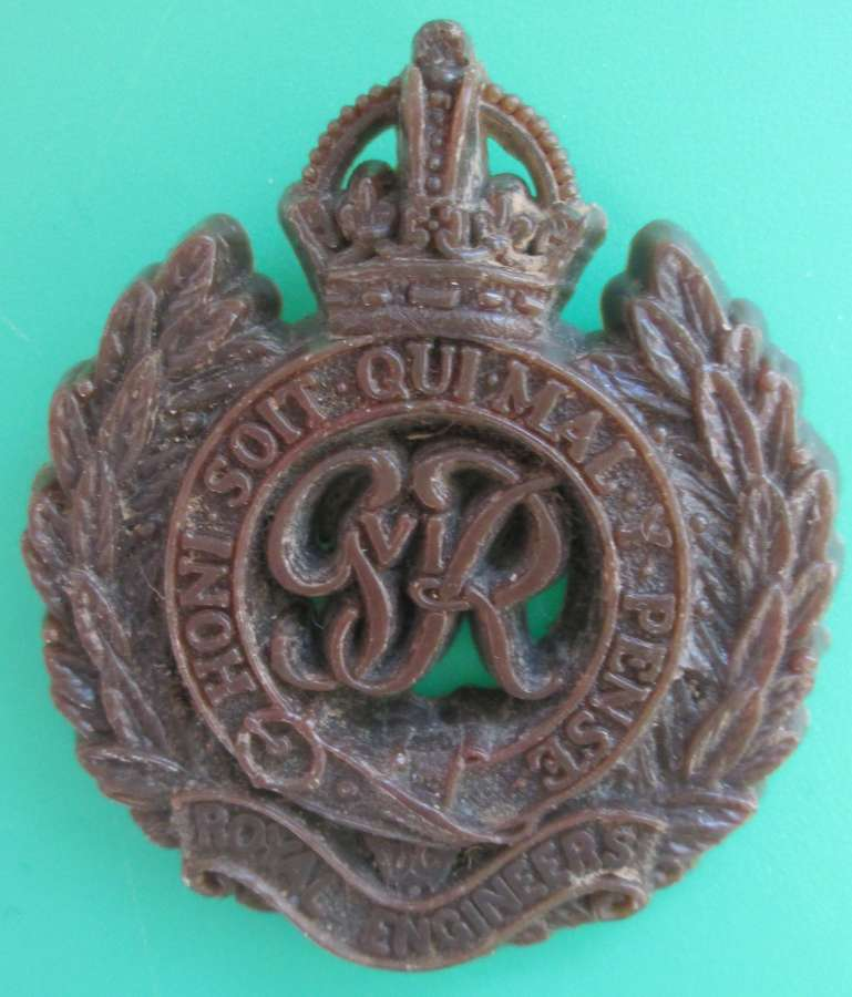 A PLASTIC ROYAL ENGINEERS BADGE