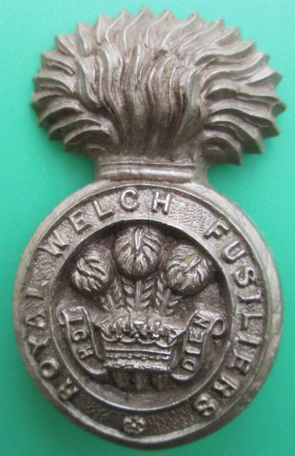 A WWII PLASTIC WELSH FUSILIERS CAP BADGE