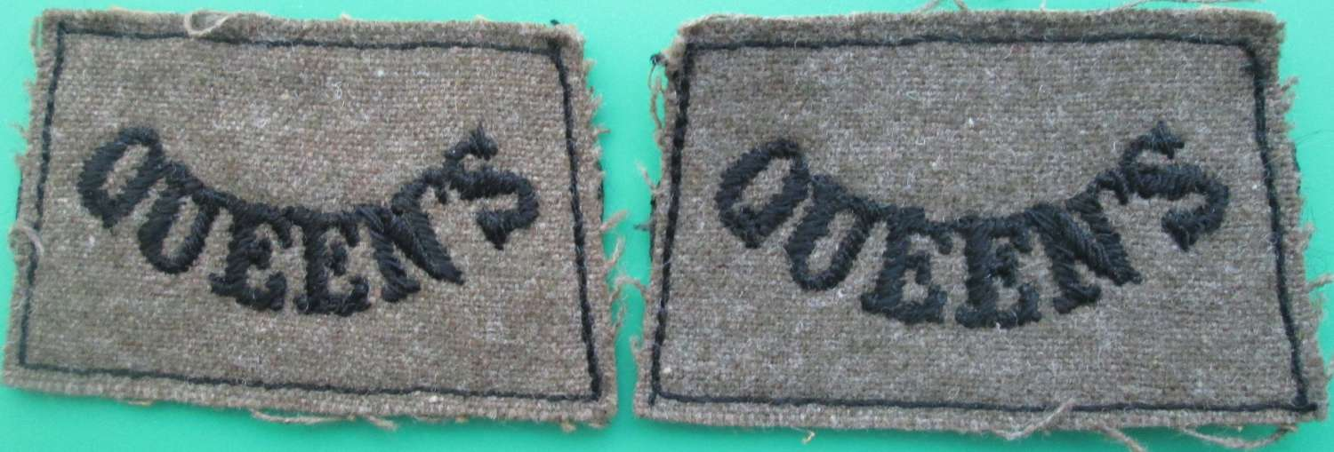 A PAIR OF QUEEN'S SLIP ON TITLES