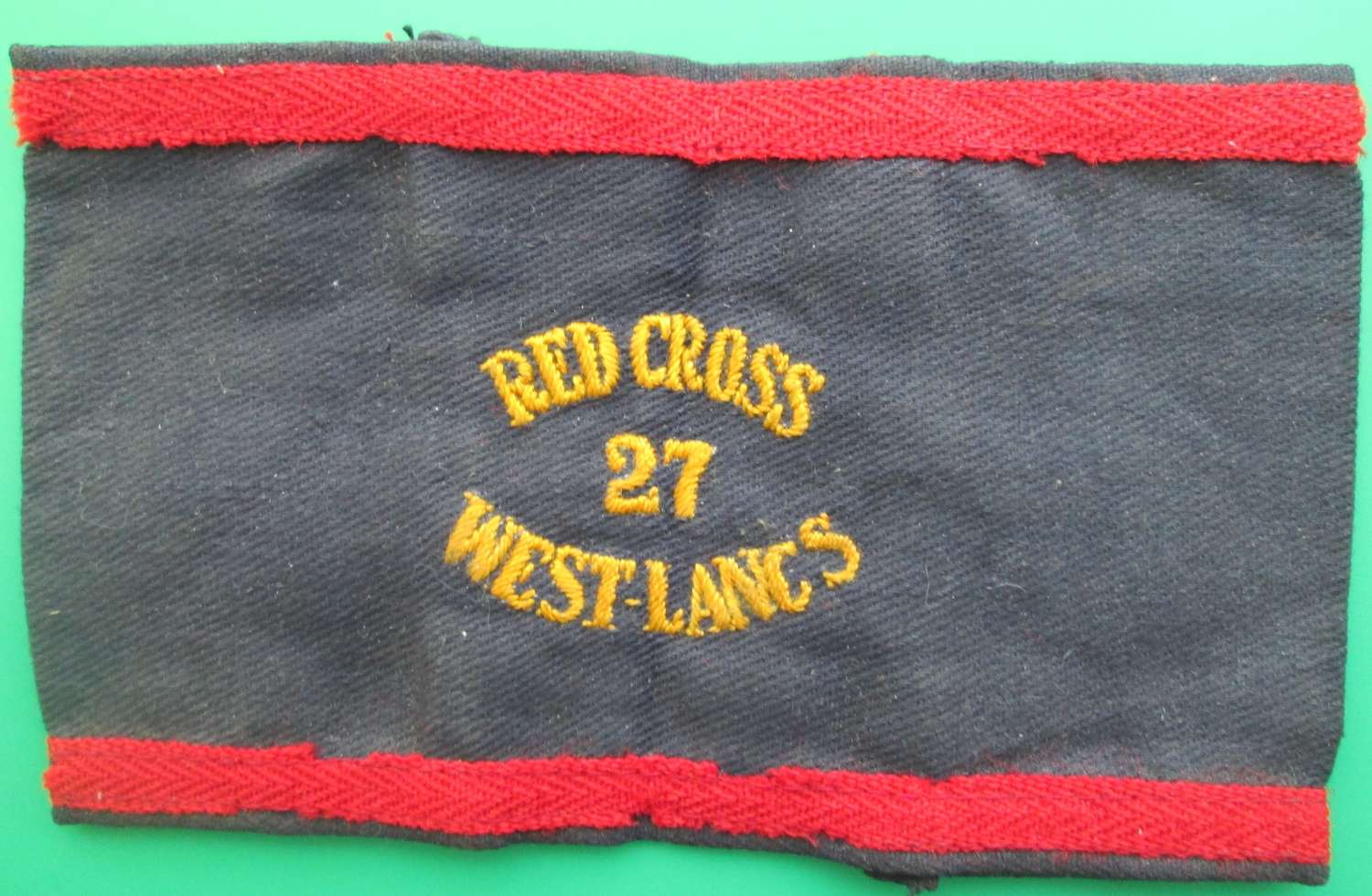 A RED CROSS ARM BAND FOR THE 27 WEST LANCS