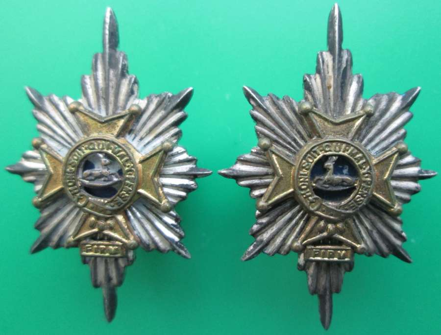 A PAIR OF OFFICERS SILVER PLATED WORCESTERSHIRE REGT COLLAR BADGES