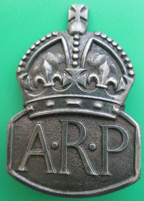 A LARGE ARP PIN BADGE
