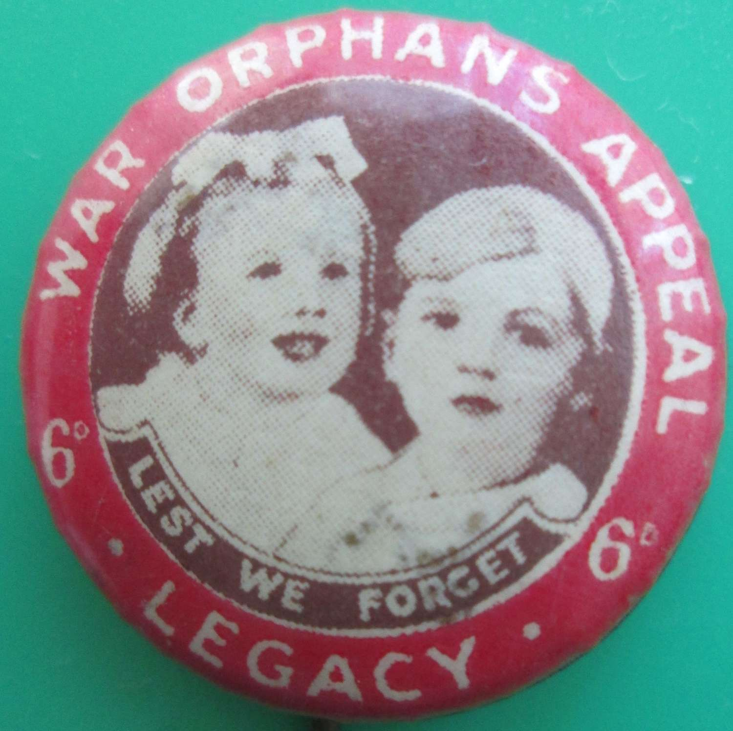A SMALL PIN BADGE FOR THE WAR ORPHANS APPEAL LEGACY