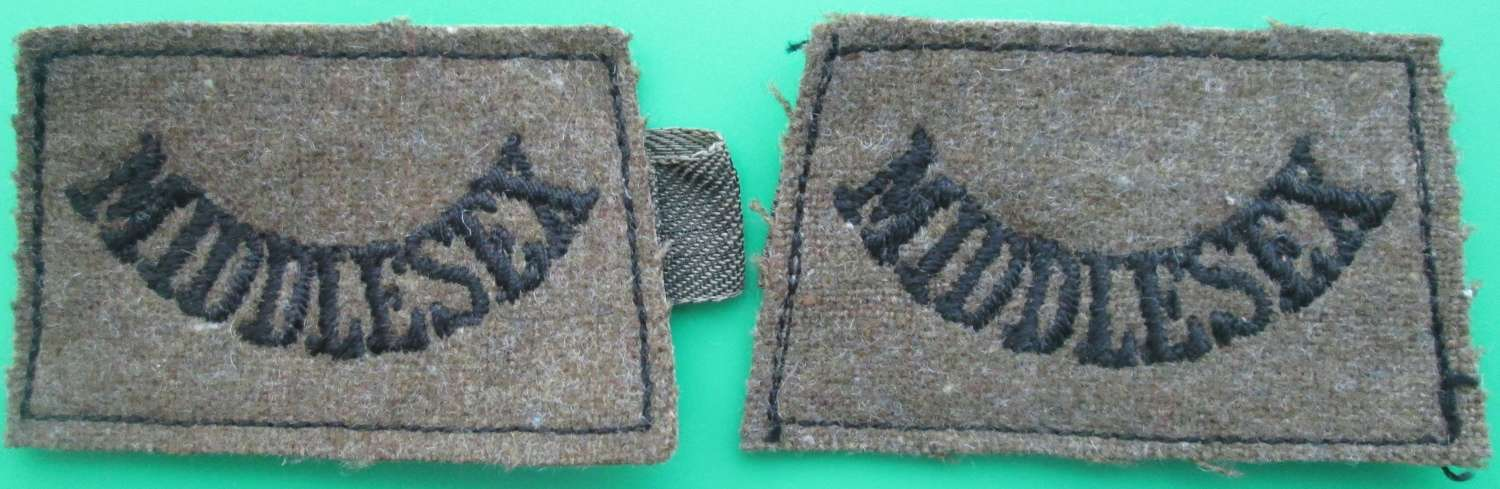 A PAIR OF MIDDLESEX REGIMENT SLIP ON TITLES