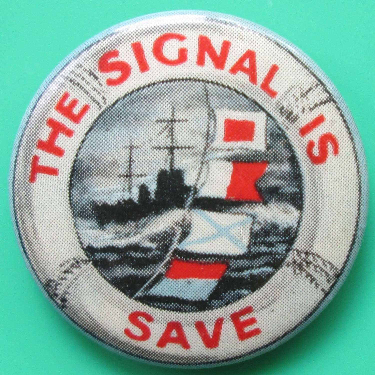 A WWII RN FUNDRAISING BADGE THE SIGNAL IS SAVE