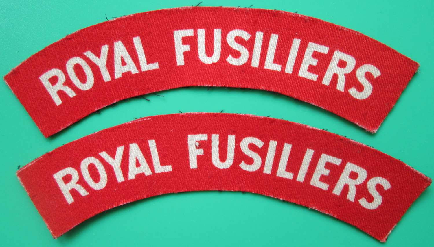 A PAIR OF ROYAL FUSILIERS SHOULDER TITLES