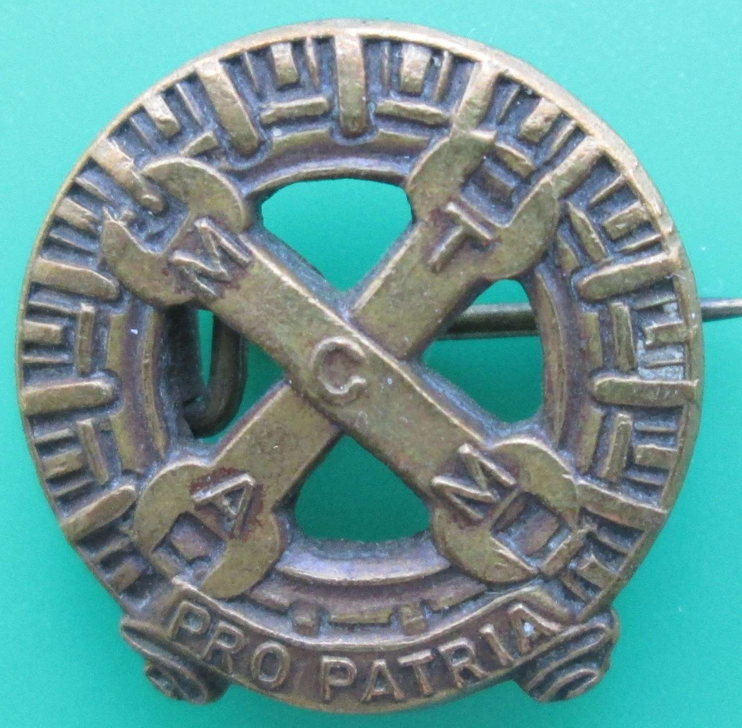 A SMALL PIN BADGE FOR THE MECHANISED TRANSPORT SERVICE