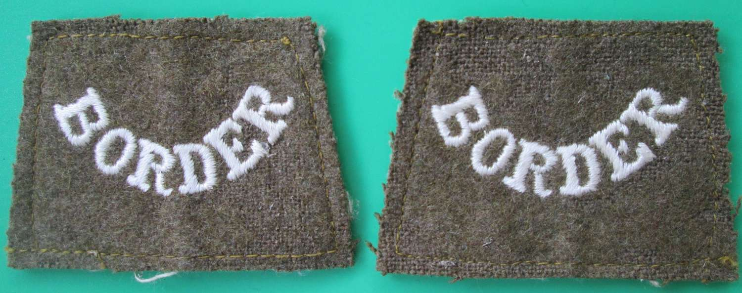 A PAIR OF WWI PERIOD BORDER REGIMENT SLIP ON TITLES