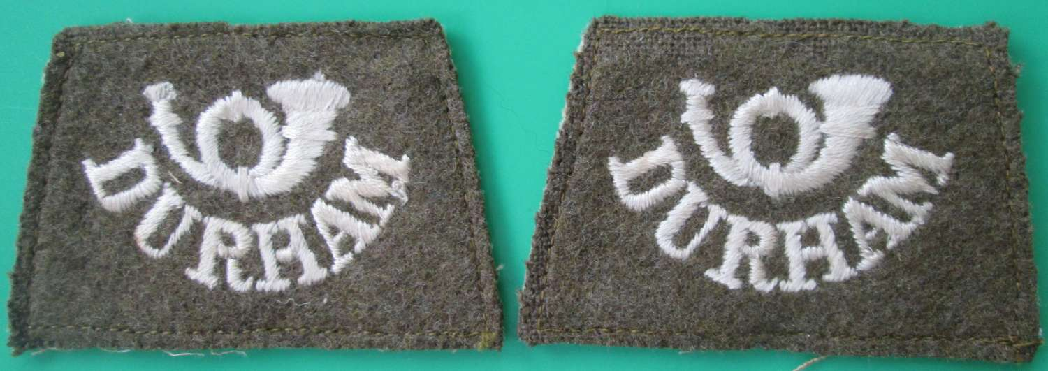 A PAIR OF WWI PERIOD DURHAM LIGHT INFANTRY SLIP ON TITLES