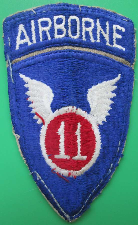 A WWII US ARMY 11TH AIRBORNE ARM BADGE SIGN