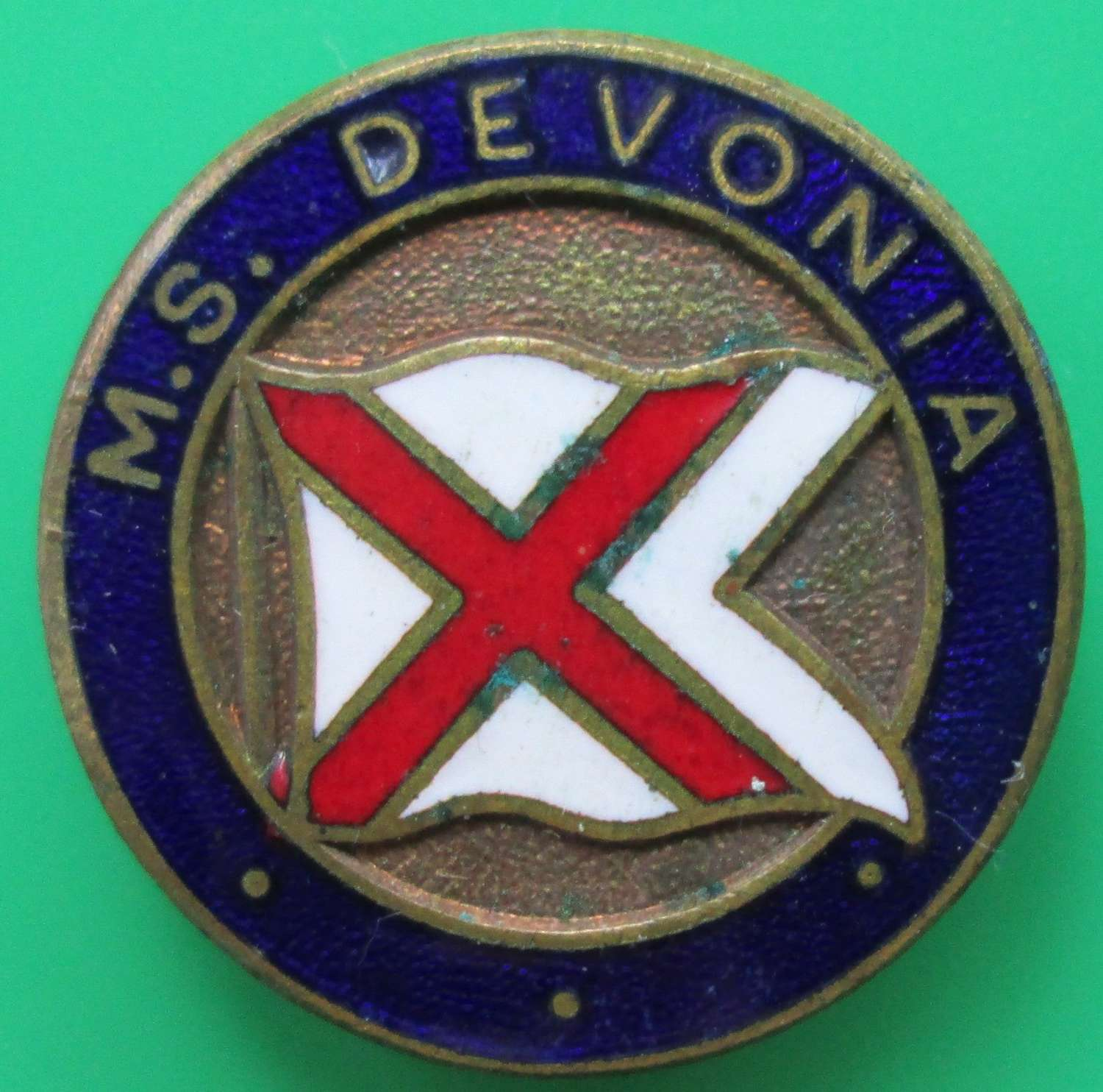 A PIN BADGE FOR THE MERCHANT SHIP DEVONIA