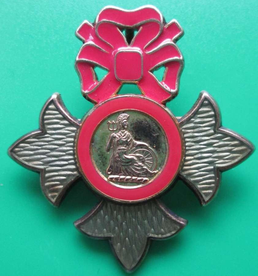 A MINATURE LADIES MBE BADGE