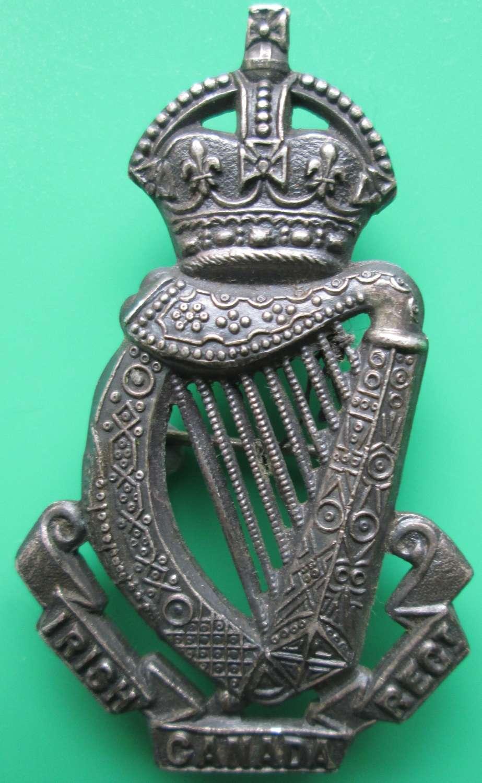 A CANADIAN IRISH REGT CAP BADGE