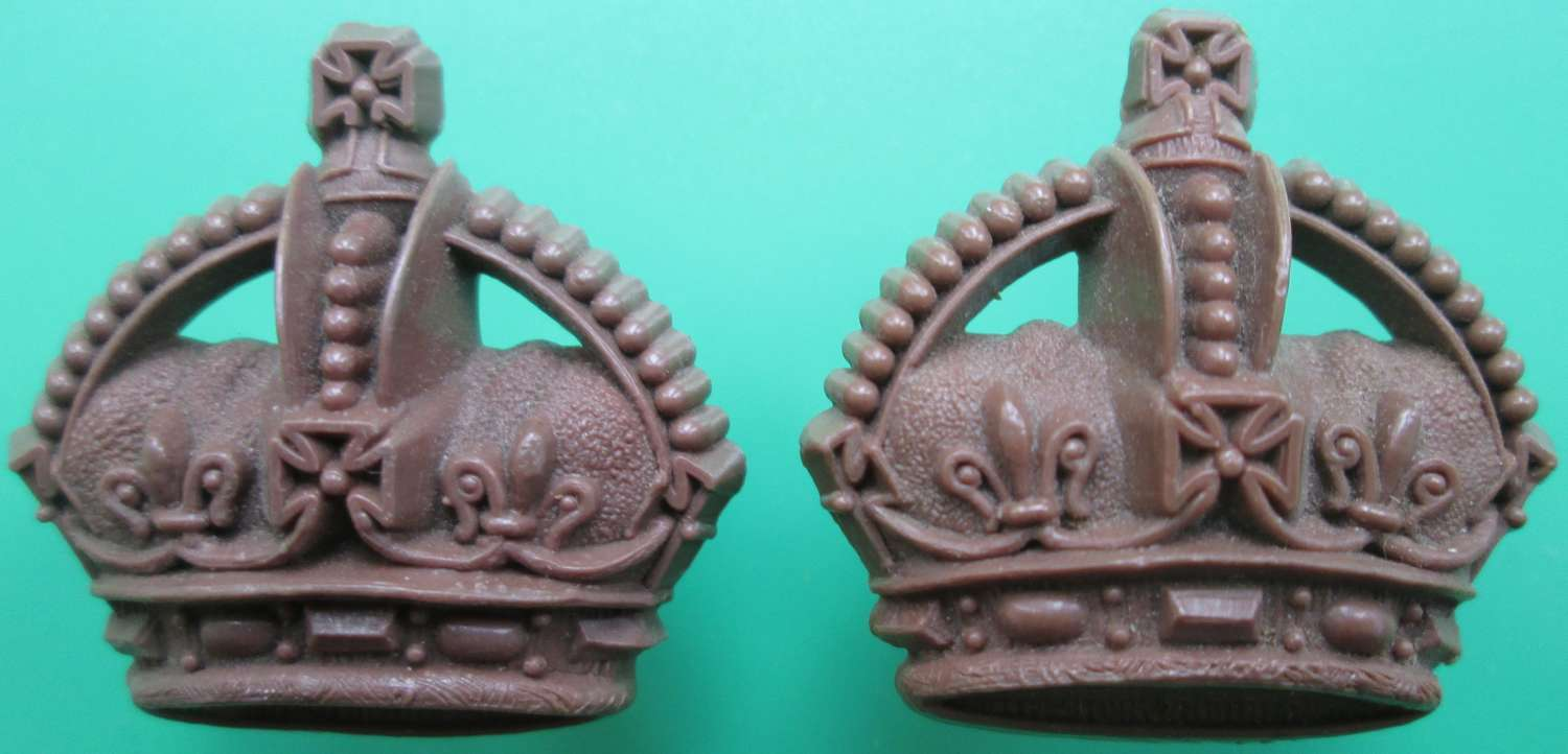 A PAIR OF PLASTIC WWII MAJORS CROWNS