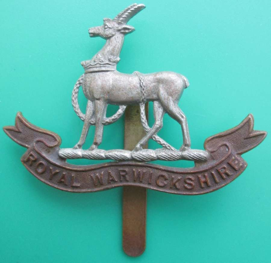 A ROYAL WARWICKSHIRE CAP BADGE