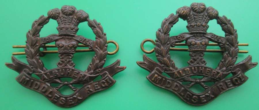 A PAIR OF OFFICERS BRONZE COLLAR DOGS FOR THE MIDDLESEX REGIMENT
