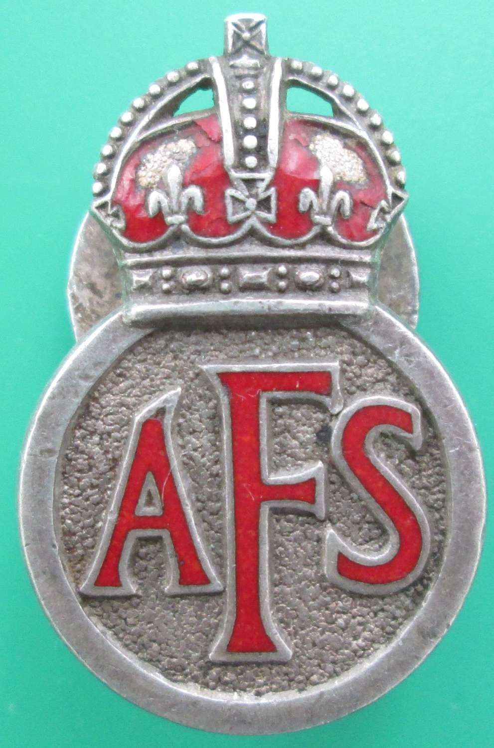 A WWII PERIOD AUXILLARY FIRE SERVICE LAPEL BADGE