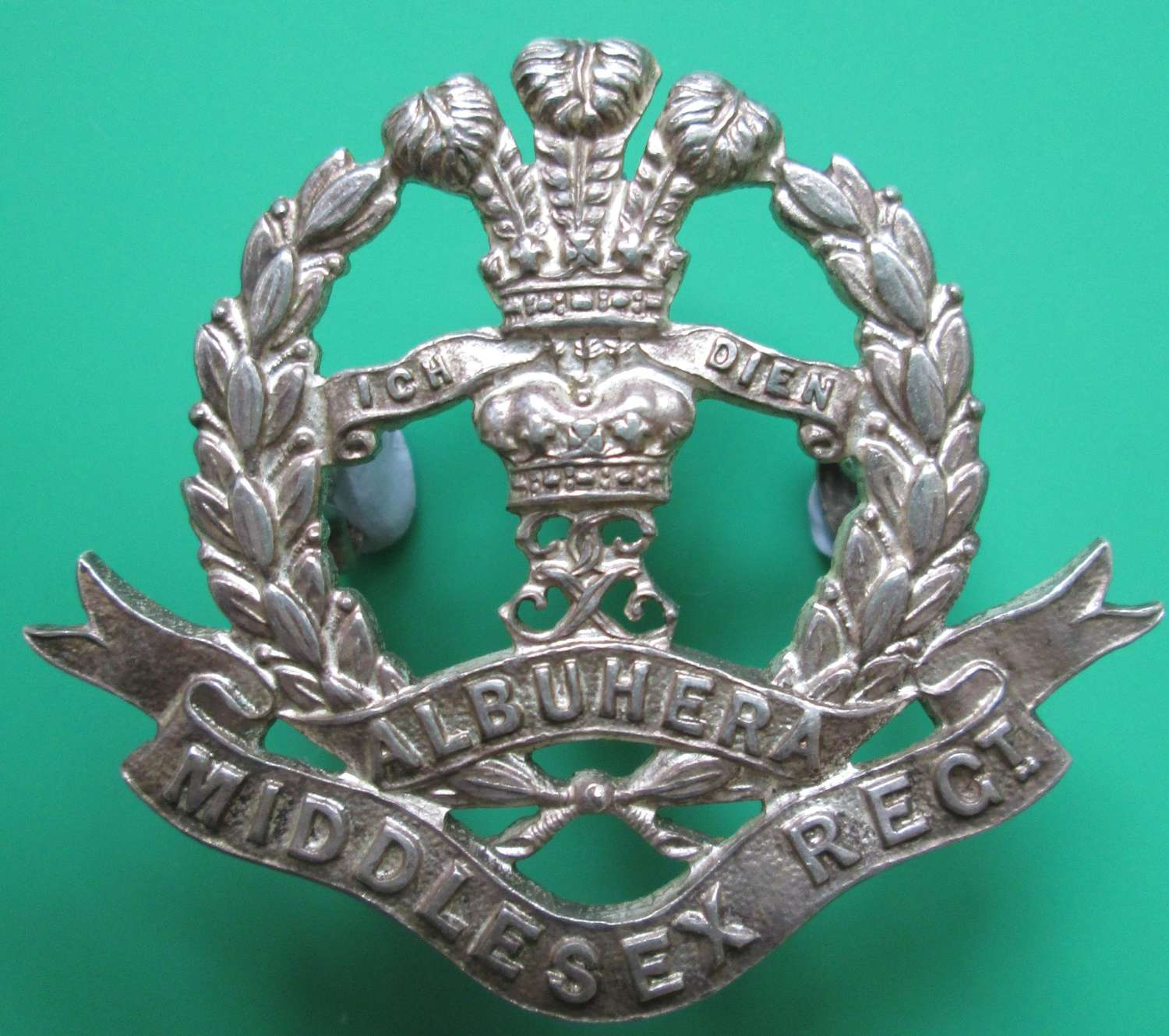 A SILVER PLATED OFFICERS MIDDLESEX REGIMENT BADGE