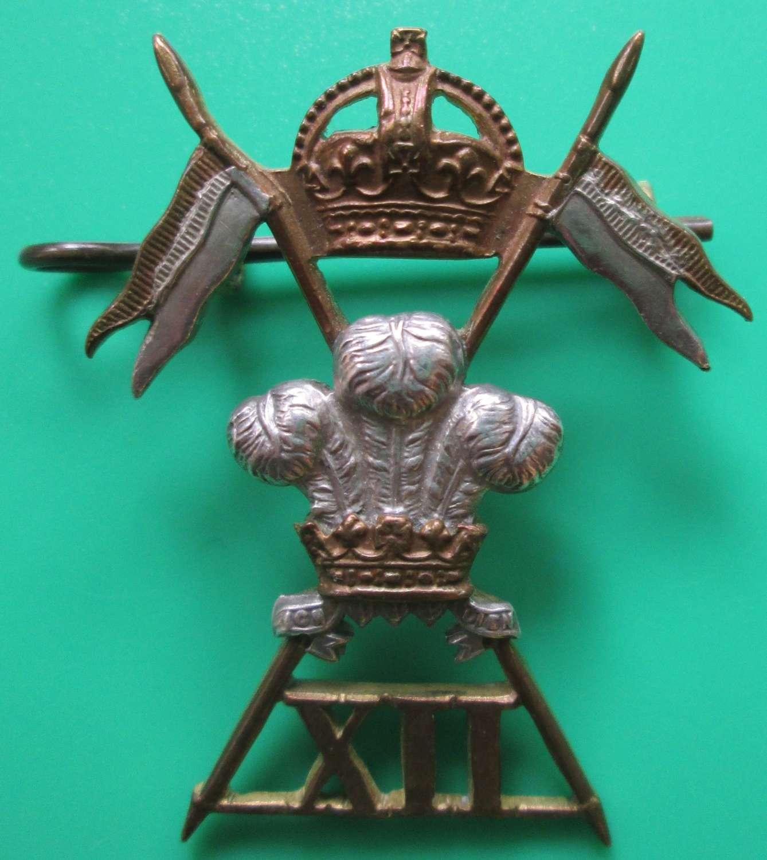 A 12th LANCERS CAP BADGE