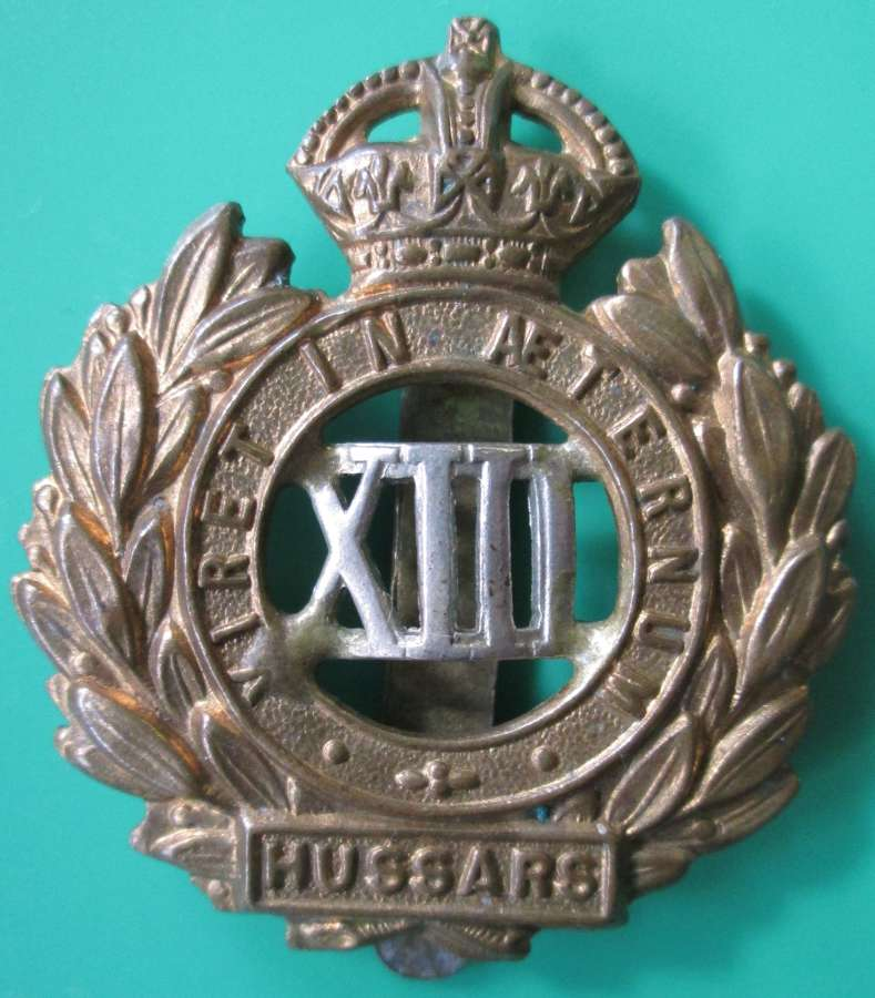 A 13TH HUSSARS CAP BADGE