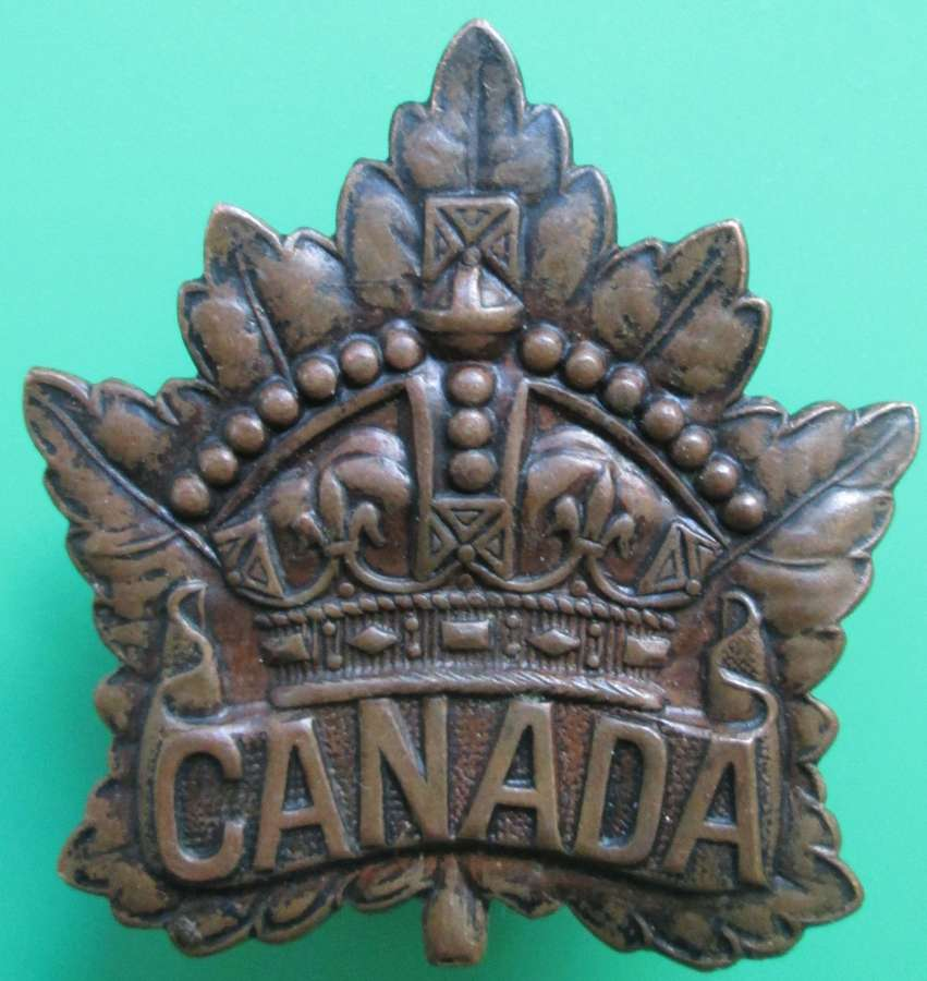 A 1916 CANADIAN CAP BADGE